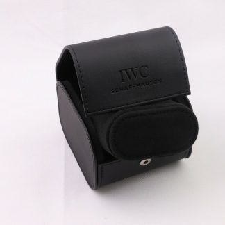 rand new never used IWC International Watch Co Watch Travel Case/watch storage box made in Black Faux Leather. The travel case comes complete set with its original carton outer box. The watch storage box fits one box and comes with a cushion that the watch is placed on.