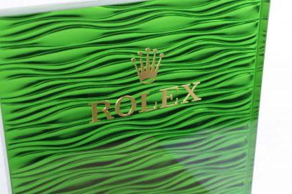 Rolex Original Watch Display Green Rolex Logo Background